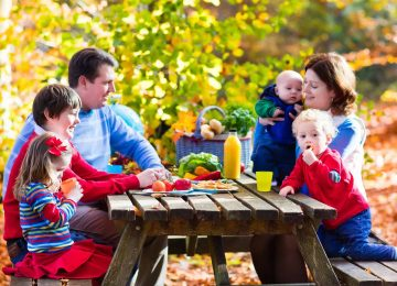 family eating at picnic table